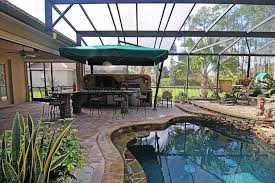 outdoor kitchen and rock tile pool