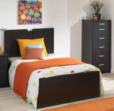single bed designs. Modern Black Corner Of Drawer With Simple Headboard Single Bed Design And Orange Accent Blanket In Colorful Bedroom Designs S