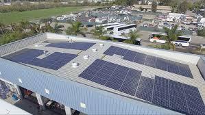monocrystalline solar panels mounted on a corrugated metal roof