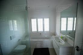 empty bathroom with hand wash basin and bathtub at home