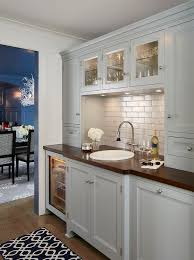 light gray butler pantry with wood countertop