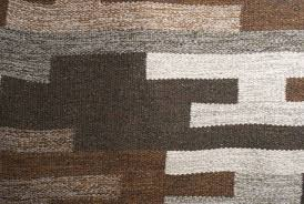 woven scandinavian modern flat weave wool rug in heathered browns grays and tan for