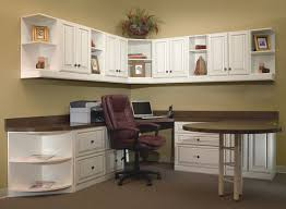wall cabinet office with home office with extended round table and lots of storage and wall