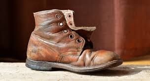 shoe wood leather antique old boot leg spring brown close human sculpture art worn footwear