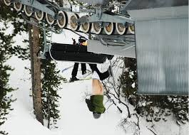 Skier naked butt on chair lift