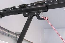 most if not all emergency latches have a small locking hole that allows you to run a small zip tie through and secure the latch