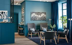 office area in living room. Waiting Room With Four Dark Grey Armchairs In A Blue Office Reception Area. Area Living