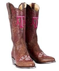 this pair of womens leather boots is perfect for the aggie lady on gameday the front of the shaft has a large maroon and white embroidered block atm and