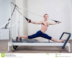 pilates reformer workout exercises man at gym stock photo image of pink indoor