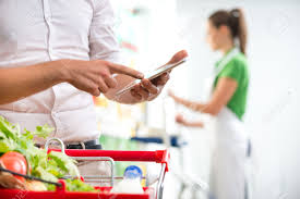 customer using a digital tablet at supermarket s clerk customer using a digital tablet at supermarket s clerk on background stock photo