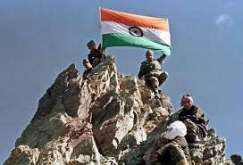indian army solrs fly the indian flag 15 july 1999 from a peak in dr after it was recaptured by indian troops during the first week of july 1999