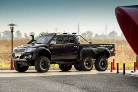 Try Off-Roading in This Six-Wheeled Toyota Hilux   Digital Trends