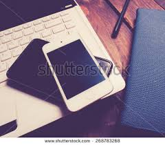 office desk laptop computer notebook mobile. office desk with laptop computer notebook mobile smartphone and pen on woodvintage