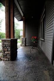 stamped concrete i like the more natural look of this style poured patio looking r2 patio
