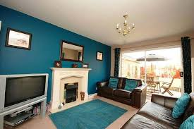brown blue living room. Living Room:Small Room Decorating Ideas With Brown Leather Sofa And Wood Flooring Plus Blue
