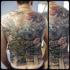 татуировки на пояснице каталог тату салонов и мастеров