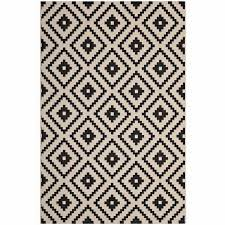 perplex geometric diamond trellis 8x10 indoor and outdoor area rug in black and beige