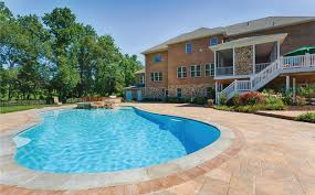Rear View Home Patio With Pool Hot Tub Outdoor Kitchen Screen