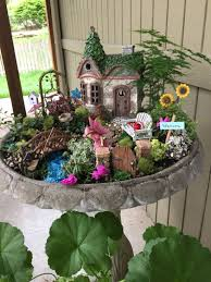 if you are looking to really draw some attention to your diy fairy garden why not put it up off of the ground so that people notice it