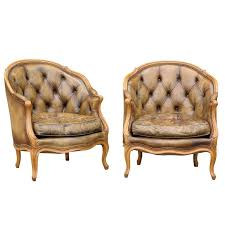 pair of 1940s french louis xv style tufted leather barrel back bergeres chairs for