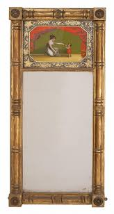 ANTIQUE AMERICAN SHERATON MIRROR Early Century Reverse-painted glass upper  panel depicts a mother and child surrounded by a foliate border. Frame with  ...