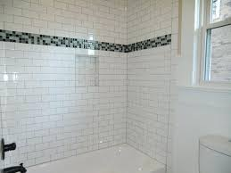 bathroom interior hot white design with subway tile bath surround along rectangular ceramic bathtub and shower