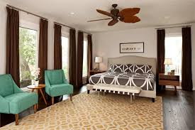 Nice Master Bedroom With Tropical Ceiling Fan And Blue Side Chairs