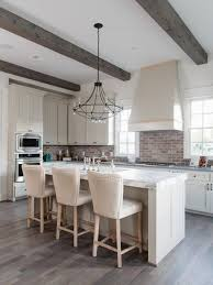 white kitchens with black appliances. Farmhouse Kitchen Remodeling - Example Of A Country U-shaped Dark Wood Floor And Brown White Kitchens With Black Appliances