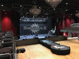 28 runway with 12 circle stage at the end covered w marley floor vinyl logo coca cola roxy atlanta