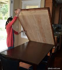 it s easy to lift the table top surface off even by myself put it to the side and mess up the table underneath as much as i want