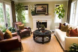 formal living room with leather chairs cream sofa and white fireplace with mantel
