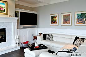 benjamin moore stonington gray paint colour white leather sectional marble fireplace surround tv built ins coffered ceiling kylie m designs e design