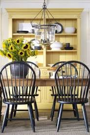 i love the burst of sunshiny yellow that this cabinet brings to the dining area