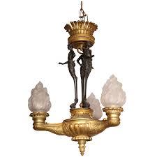 bronze empire chandelier with figural pan standard
