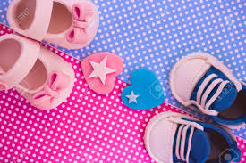 Boy Or Girl Baby Announcement Girl And Boy Baby Shoes On Blue And Pink Background Is It A