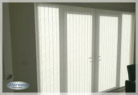 vertical blind with metallic pelmet on patio doors