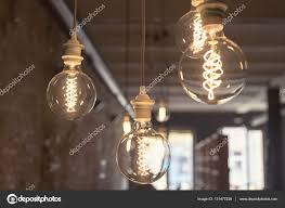 vintage style round light bulbs hanging from the ceiling stock photo
