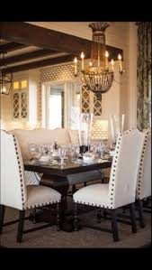 love the contrasting nailhead trim on these dining chairs and how that ties in with the dark finish on the table and utilizing a bench instead of single