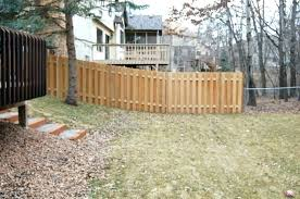 how to install a wooden fence building a fence on a slope installing a wood fence