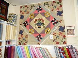 Beehive Quilts: Friends Around the Block quilt store in Colusa CA & In the back of the store is their long arm. A lady had come in just before  me to pick up her quilt and brought it up front to share with the ... Adamdwight.com