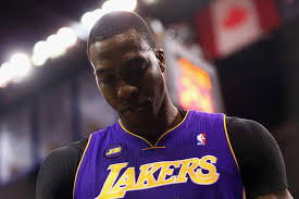Lakers fans react to Dwight Howard's departure by burning jerseys.