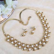 white pearl neckpiece with earring