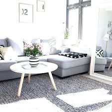 rug for gray couch grey couch in living room coma studio navy rug gray couch