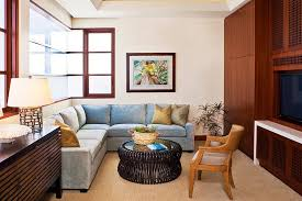 beach style tv room with a comfy sectional design jeremy harnish designer finishes