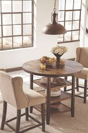 satisfy your vintage modern taste with these round counter height dining tables and upholstered wingback counter