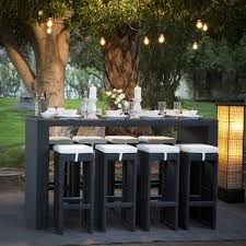 bar height patio chair:  height patio chairs with rectangular bar height patio table and candles on the table