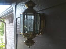 changing the light bulb in an outdoor fixture img00424 20100612 1858 jpg