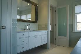 wood framed bathroom door with frosted glass interior