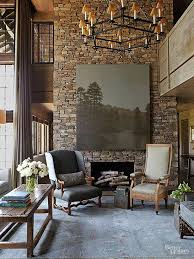 The play of light and shadows across a stacked-stone fireplace brings a  mesmerizing quality to any interior. Here, native Alabama fieldstone towers  to the ...