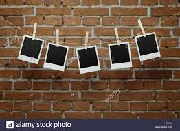 How To Hang Rope Lights On Brick Blank Instant Photographs Hanging On The Rope Stock Photo